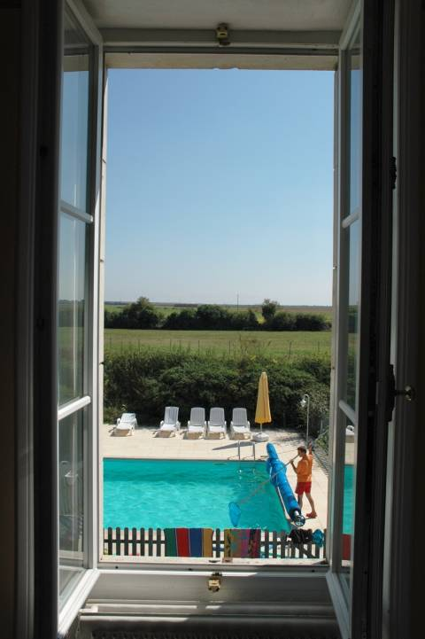 Les Ardoises the view over the pool from the master bedroom